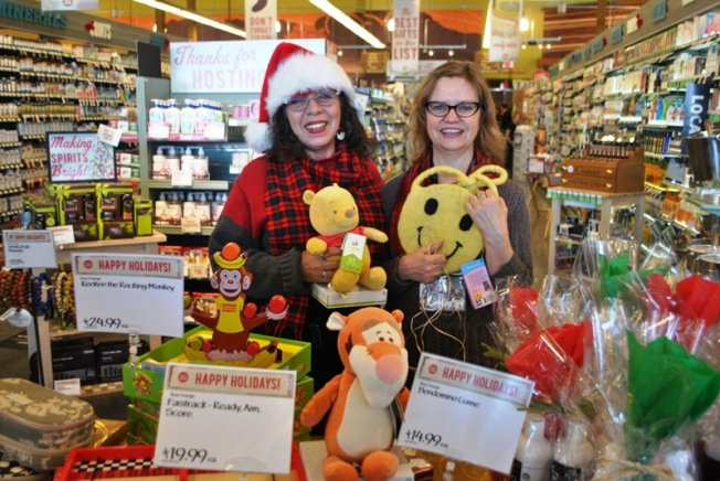 Carolyn and Julie, awesome Whole Foods staff sharing the excellent merchandise