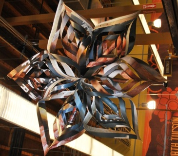 A recycled snowflake holiday decoration.  Only Whole Foods would think up something this clever!